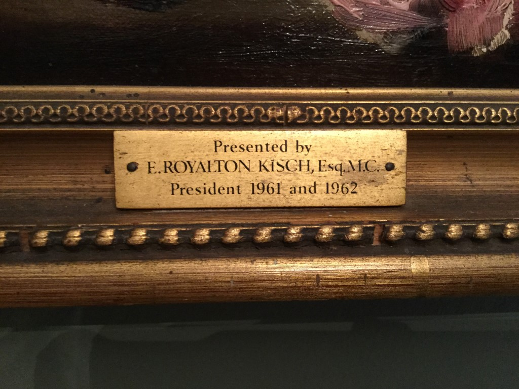 Presentation plaque on the frame of the painting.